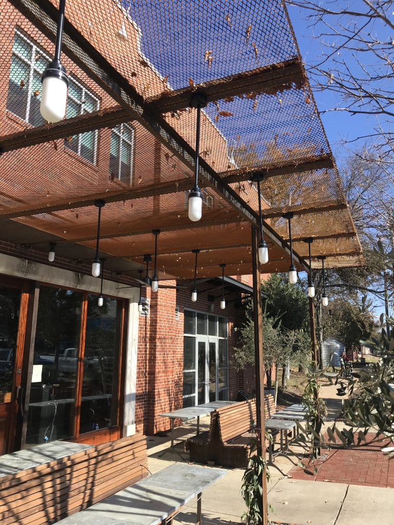 Weathering Steel Outdoor Dining Space